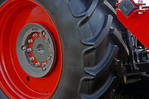 http://www.dreamstime.com/stock-photography-large-red-wheel-rim-rubber-image29563612